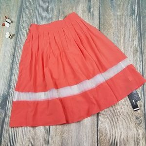 New coral pleated skirt with see through detail